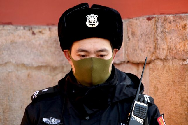 A Chinese police officer wears a protective masks in Beijing on Thursday to guard against an outbreak of a coronavirus.  Photo by Stephen Shaver/UPI