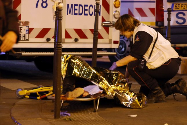 Victims of the shooting at the Bataclan concert venue in central Paris are being evacuated to receive first aid on November 14, 2015. File Photo by Maya Vidon-White/UPI