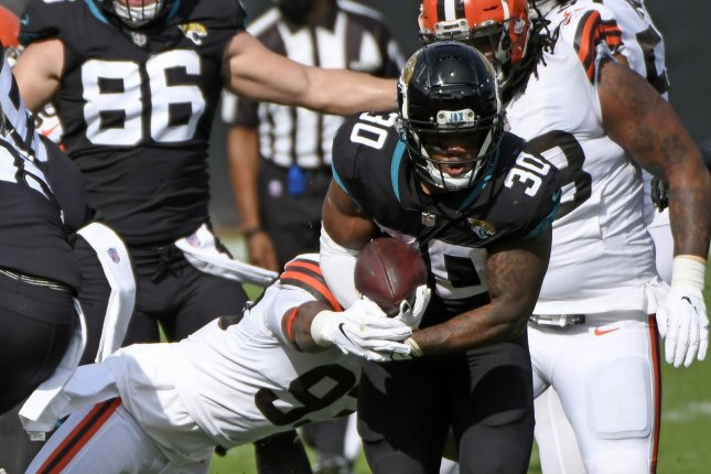 Jacksonville Jaguars running back James Robinson (30) runs for a short gain in the first quarter against the Cleveland Browns on Sunday at TIAA Bank Field in Jacksonville, Fla. Photo by Joe Marino/UPI