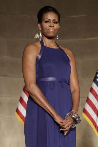 First Lady Michelle Obama listens as U.S. President Barack Obama speaks at the the Pritzker Architecture Prize Event in Washington, DC on June 2, 2011. UPI/Yuri Gripas/Pool
