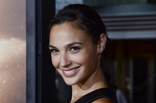 Actress Gal Gadot attends the premiere of the sci-fi motion picture thriller Riddick, at the Regency Village Theatre in the Westwood section of in Los Angeles on August 28, 2013. Left for dead on a sun-scorched planet, Riddick fights for survival against alien predators, seeking to escape the planet activates an emergency beacon alerting two ships: one carrying a new breed of mercenary, the other captained by a man from Riddick's past. UPI/Jim Ruymen