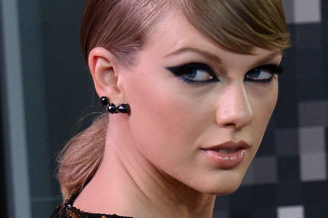 Singer Taylor Swift posted a cheeky message on Twitter commenting on recent rumors she and boyfriend Calvin Harris are looking to marry. Photo by Jim Ruymen/UPI