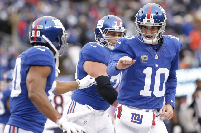 New York Giants QB Eli Manning celebrates a touchdown with Victor Cruz in the 3rd quarter against the Chicago Bears in the second half in week 11 of the NFL at MetLife Stadium in East Rutherford, New Jersey on November 20, 2016. The Giants defeated the Bears 22-16. Photo by John Angelillo/UPI