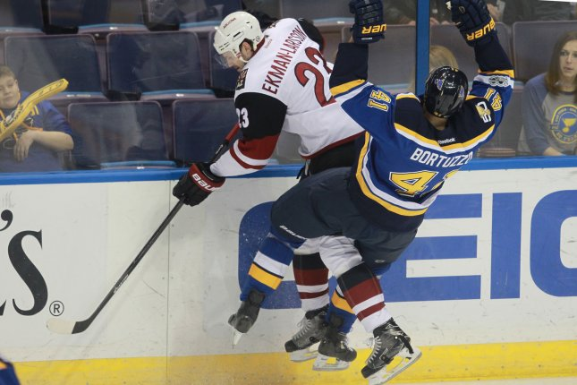 Arizona Coyotes Oliver Ekman-Larsson and St. Louis Blues Robert Bortuzzo collide during the first period at the Scottrade Center in St. Louis on March 27, 2017. Photo by Bill Greenblatt/UPI