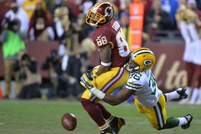Former Green Bay Packers cornerback LaDarius Gunter (36) breaks up a pass intended for former Washington Redskins wide receiver Pierre Garcon (88). File photo by Kevin Dietsch/UPI