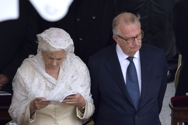 Belgium's Queen Paola (L) and King Albert II attend canonization mass in St. Peter's Square at the Vatican in Vatican City on April 27, 2014. On August 9, 1993, King Albert II of Belgium was crowned 10 days after King Baudouin I, his older brother, died of heart failure. File Photo by Stefano Spaziani/UPI