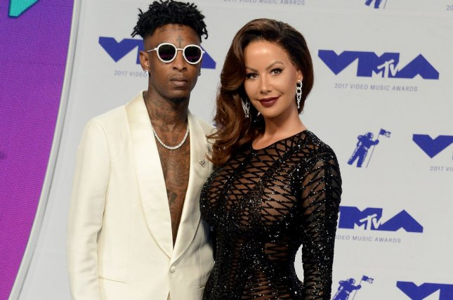 (L-R) 21 Savage, pictured here with Amber Rose, has had the No. 1 album in the United States for two consecutive weeks. File Photo by Jim Ruymen/UPI