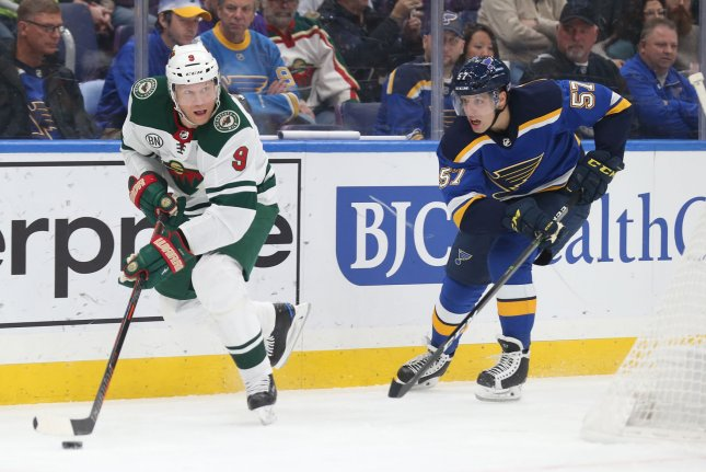 Minnesota Wild captain Mikko Koivu (L) will miss the rest of the reason after sustaining a serious knee injury Tuesday. File photo by Bill Greenblatt/UPI