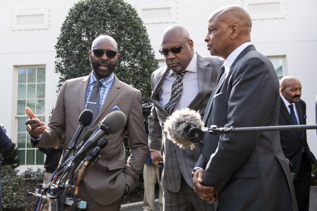 Left to right, NFL greats Jerry Rice, Charles Haley, and Ronnie Lottspeak to the media after President Donald Trump pardoned ex-San Francisco 49ers owner Edward DeBartolo Jr., at the White House on Tuesday. Photo by Kevin Dietsch/UPI