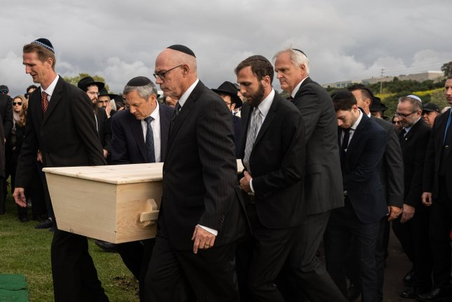 Mourners carry the casket of Lori Gilbert Kaye at El Camino Cemetery in San Diego, Calif., on April 29, 2019. Kaye had been killed in a shooting attack at the Chabad of Poway Synagogue. File Photo by Ariana Drehsler/UPI
