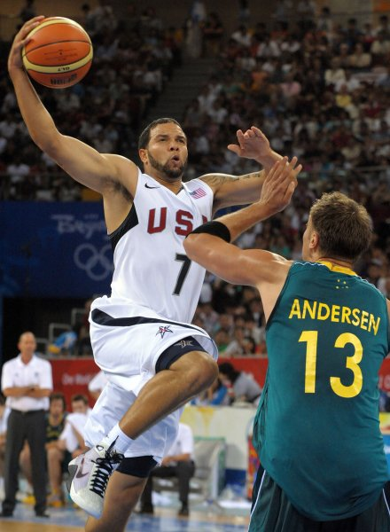 USA's Deron Williams goes over Australia's David Anderson in the fourth quarter during Men's Basketball quarter finals at the 2008 Summer Olympics in Beijing on August 20, 2008. (UPI Photo/Roger L. Wollenberg)