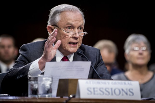 Attorney General Jeff Sessions testifies at a hearing of the Senate Select Intelligence Committee on Capitol Hill in Washington, D.C., on June 13. On Tuesday, the Justice Department said it would withhold federal grant money to cities with sanctuary policies. File Photo by Pete Marovich/UPI