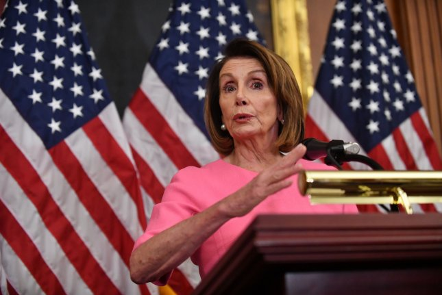 House Democratic leader Nancy Pelosi asked Capitol Police to allow demonstrators gather outside her office in support of a climate change plan. Photo by Pat Benic/UPI