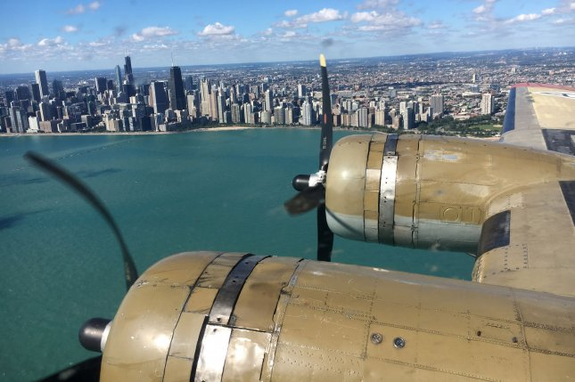 A Boeing B-17G owned by the Collings Foundation flies by downtown Chicago as part of a nationwide tour of historic aircraft in 2017. File Photo by Brian Kersey/UPI