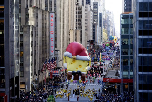 The SpongeBob SquarePants balloon and other balloons and floats move down the parade route on Sixth Avenue at the 92nd Macy's Thanksgiving Day Parade in New York City on November 22, 2018. Accuweather forecasts winds will become strong and gusty over much of the Northeast from Wednesday afternoon into Thanksgiving Day. File Photo by John Angelillo/UPI