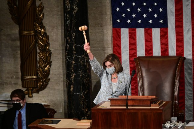 U.S. Speaker of the House Nancy Pelosi wields the Speaker's gavel after being re-elected on Sunday. Pool photo by Erin Scott/UPI