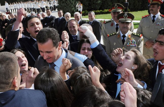Syrian President Bashar al-Assad(L) is greeted by children of soldiers during a ceremony to mark Martyrs' Day at the Tomb of the Unknown Soldier in Damascus May 6, 2011. UPI/Handout..