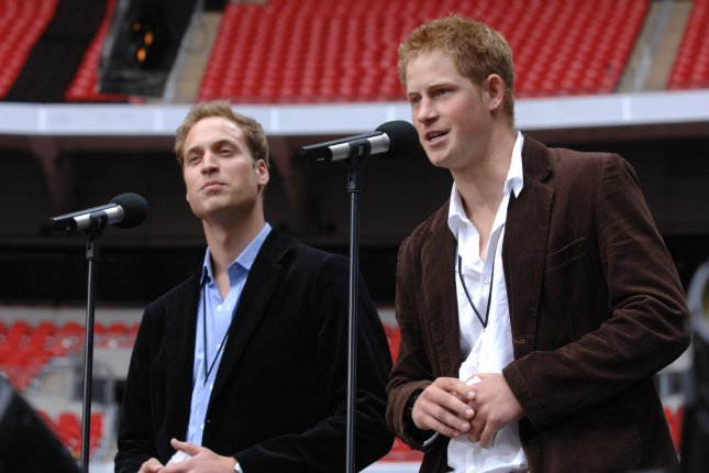Prince William (L) and Prince Harry at Wembley Stadium in 2007. File photo by Rune Hellestad/UPI