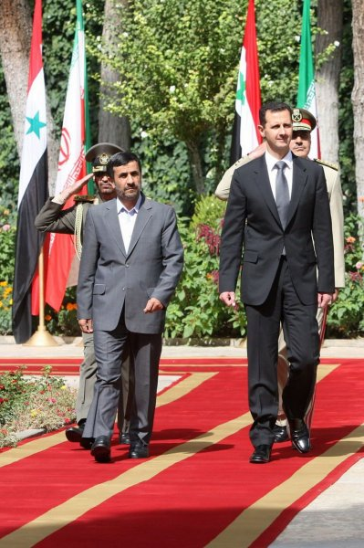 Iranian President Mahmoud Ahmadinejad (L) welcomes his Syrian counterpart Bashar al-Assad during an official welcoming ceremony on October 2, 2010 at the Presidential Palace in Tehran, Iran. UPI