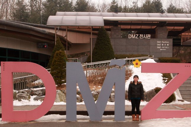 A tourist poses for a photo at a visitor center in part of the Demilitarized Zone (DMZ) near Seoul. (Stephen Shaver/UPI)
