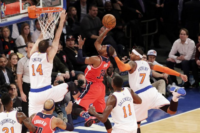 New York Knicks Carmelo Anthony watches Washington Wizards Paul Pierce drive to the basket in the first half at Madison Square Garden in New York City on November 4, 2014. UPI/John Angelillo