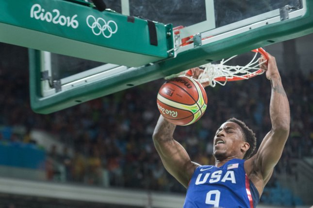 United States guard Demar DeRozan (9) hangs from the hoop after dunking the ball during basketball competition at the Carioca Arena 1 in Rio de Janeiro, Brazil, August 6, 2016. The USA team crushed China 119-62. Photo by Richard Ellis/UPI
