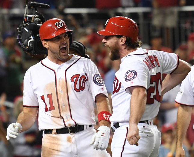 The Washington Nationals' Ryan Zimmerman (11) celebrates his three-run, game-winning home run with Daniel Murphy in the eighth inning against the Chicago Cubs in Game 2 of the NLDS at Nationals Park on Saturday. Photo by Pat Benic/UPI