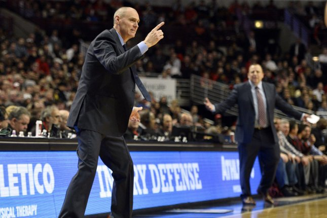 Dallas Mavericks head coach Rick Carlisle (L) yells at the referees during the fourth quarter on December 2, 2014 at the United Center in Chicago. File photo by Brian Kersey/UPI