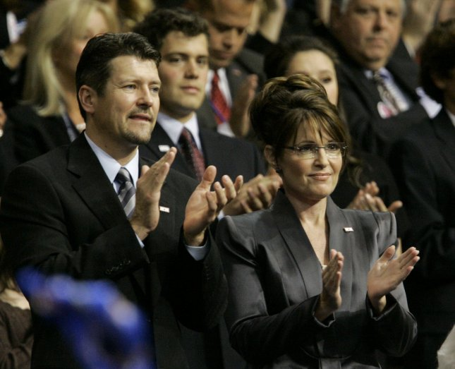 Republican Vice Presidential candidate Alaska Gov. Sarah Palin (R) and her husband Todd applaud Republican Presidential candidate Sen. John McCain (R-AZ) as he delivers his acceptance speech on the fourth day of the Republican National Convention at the Xcel Energy Center in St. Paul, Minnesota on September 4, 2008. (UPI Photo/Brian Kersey)