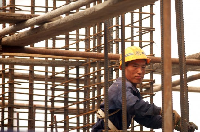 A Chinese migrant worker handles rebar at a commercial construction site in central Beijing September 29, 2010. Chinese Premier Wen Jiabao said Thursday that the government will keep housing prices at a reasonable and stable level. Wen said the nation will improve support for the elderly, medical care and other social security schemes, to allow all the citizens to benefit from China's economic growth. UPI/Stephen Shaver