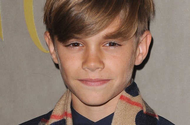 English child model Romeo Beckham attends the Burberry Festive Film Premiere at Burberry Regent Street in London on Tuesday. Photo by Paul Treadway/UPI