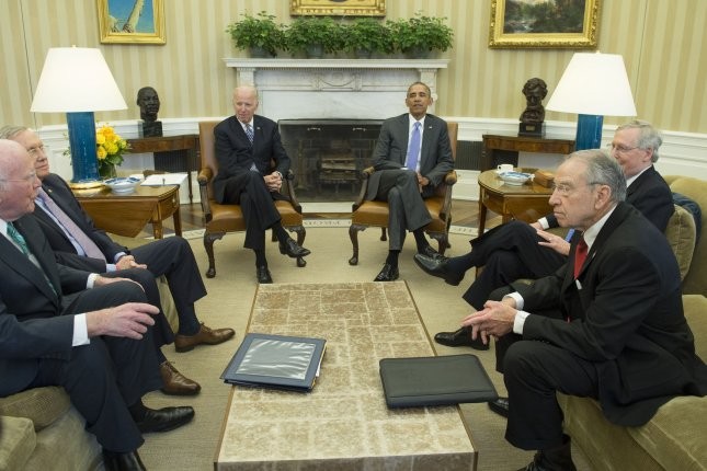President Barack Obama meets with Vice President Joe Biden and bipartisan leaders of the Senate and members of the Judiciary Committee to discuss the Supreme Court vacancy left by the Feb. 13 death of Justice Antonin Scalia, in the Oval Office of the White House in Washington, D.C., on Tuesday. Obama met with, from left to right, Sen. Patrick Leahy, D-Vt., Senate Minority Leader Harry Reid, D-Nev., Senate Majority Leader Mitch McConnell, R-Ky., and Sen. Chuck Grassley, R-Ia.. Photo by Kevin Dietsch/UPI