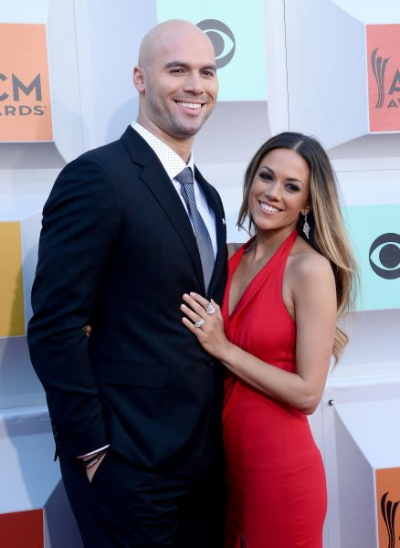 Jana Kramer (R) and Mike Caussin at the Academy of Country Music Awards on April 3. File Photo by Jim Ruymen/UPI
