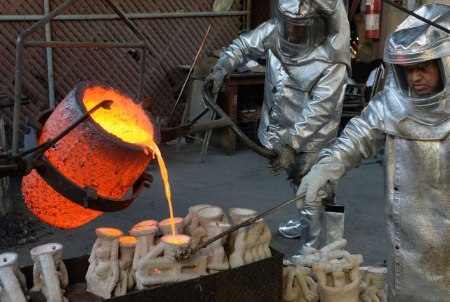 Workers in fire suits pour molten bronze metal into molds during the casting of the Screen Actors Guild Award statuettes at the American Fine Arts Foundry in Burbank, California on Tuesday. Winners are to be announced during a live simulcast on TNT and TBS in Los Angeles on January 29, 2017. Photo by Jim Ruymen/UPI