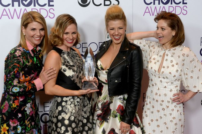(L-R) Actresses Lori Loughlin, Andrea Barber, Jodie Sweetin and Candace Cameron Bure appear backstage with their award for Favorite Premium Comedy Series for Fuller House during the 43rd annual People's Choice Awards in Los Angeles on January 18. Season 3 is to begin Sept. 22 on Netflix. File Photo by Jim Ruymen/UPI