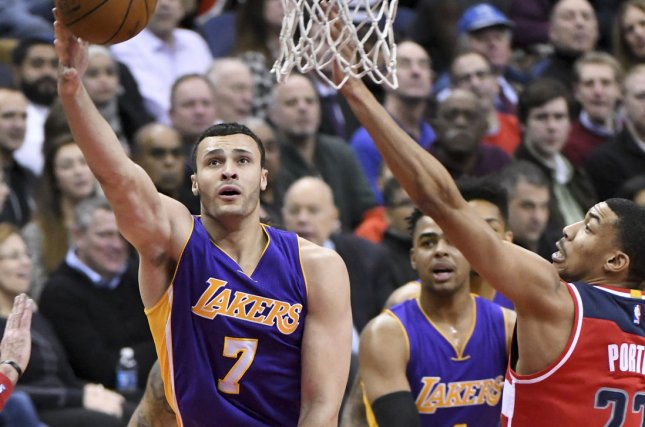 Los Angeles Lakers forward Larry Nance Jr. (7) scores against Washington Wizards forward Otto Porter Jr. (22) in the first half at the Verizon Center in Washington, D.C. on February 2, 2017. File photo by Mark Goldman/UPI