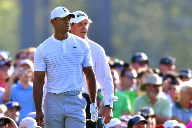 Tiger Woods (L) and Phil Mickelson watch together on the 12th tee during a practice round prior to the Masters golf tournament Tuesday at the Augusta National Golf Club in Augusta, Ga. Photo by Kevin Dietsch/UPI