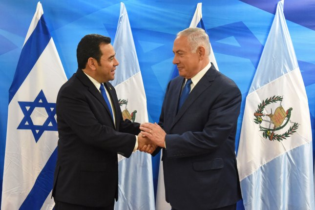 Guatemalan President Jimmy Morales (L) shake hands with Israeli Prime Minister Benjamin Netanyahu in his office in Jerusalem on Wednesday. Photo by Debbie Hill/UPI