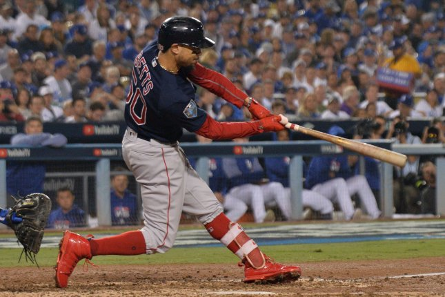 Boston Red Sox outfielder Mookie Betts (50) hits a solo home run off Los Angeles Dodgers starting pitcher Clayton Kershaw in the sixth inning in Game 5 of the 2018 World Series on October 28 at Dodger Stadium in Los Angeles. Betts avoided arbitration with a deal on Friday. Photo by Jim Ruymen/UPI