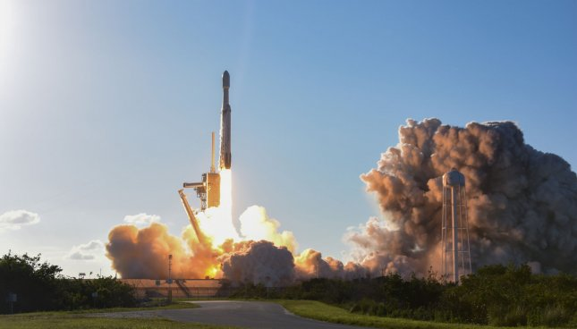 SpaceX's Falcon Heavy rocket launches Thursday from Kennedy Space Center, Florida. Photo by Joe Marino-Bill Cantrell/UPI