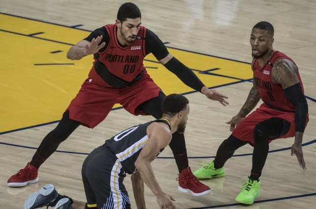 Former Portland Trail Blazers center Enes Kanter (L) was linked to the Los Angeles Lakers and Chicago Bulls before opting to sign with the Boston Celtics in free agency. File Photo by Terry Schmitt/UPI