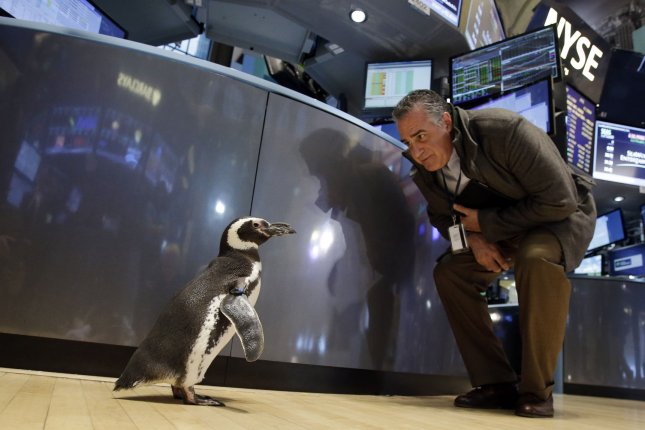 A penguin walks on the floor of the NYSE after SeaWorld Entertainment Inc. rings the closing bell at the New York Stock Exchange on January 15, 2014. On Friday, the company said it's furloughing 90 percent of its workforce. File photo by John Angelillo/UPI