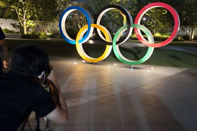 People gather to take photos Friday at the National Stadium in Tokyo on Friday. Photo by Keizo Mori/UPI