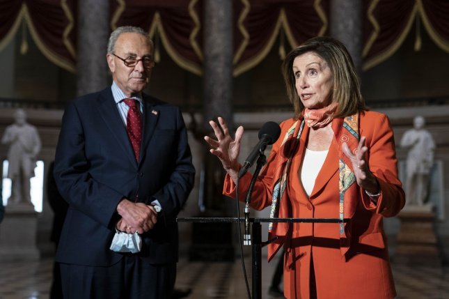 House Speaker Nancy Pelosi and Senate Democratic leader Chuck Schumer speak to the press in Statuary Hall following a meeting with White House chief of staff Mark Meadows and Secretary of the Treasury Steven Mnuchin in Washington, D.C., on Tuesday. Photo by Sarah Silbiger/UPI