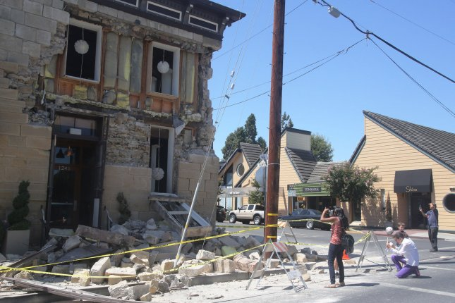 People take photos of a damaged wine tasting room after a 6.0-magnitude earthquake struck in Napa, Calif., in August 2014, along a fault line believed to be the northern extension of the Calaveras Fault. File Photo by David Yee/UPI