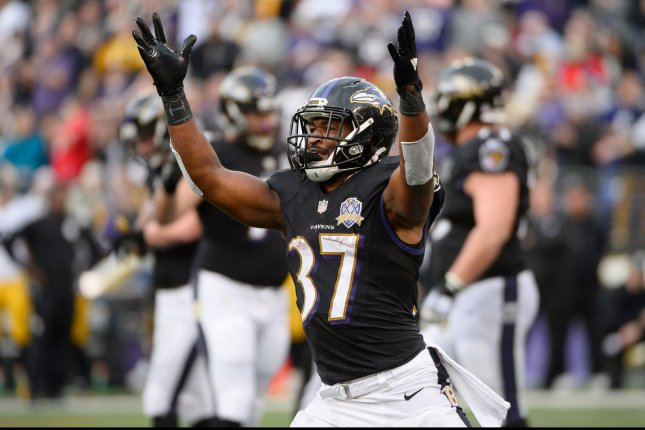 Baltimore Ravens' Javorius Allen (37) celebrates after scoring on a three yard run over the Pittsburgh Steelers during the second half of their NFL game at M&T Bank Stadium in Baltimore, Maryland, December 27, 2015. Baltimore won 20-17. Photo by David Tulis/UPI