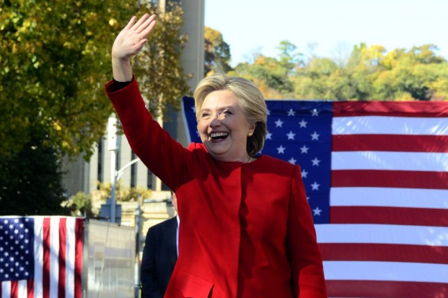 Democratic presidential candidate Hillary Clinton waves to supporters as she departs the Cathedral of Learning on the campus of the University of Pittsburgh, one of multiple campaign stops in four states Monday. Photo by Archie Carpenter/UPI