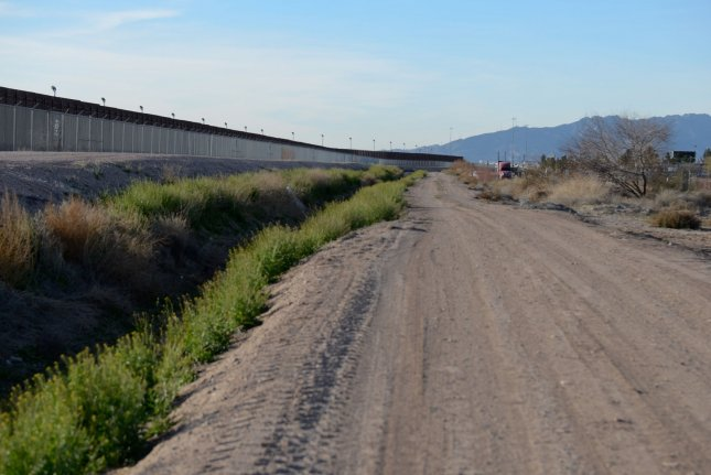 The border fence that connects El Paso, Texas, to Juarez, Mexico, runs next to a landscaping business just off the 375 loop freeway on February 12, 2019. Texas Gov. Greg Abbott said he wants to finish building a border wall along the entire Texas border with Mexico. File Photo by Natalie Krebs/UPI