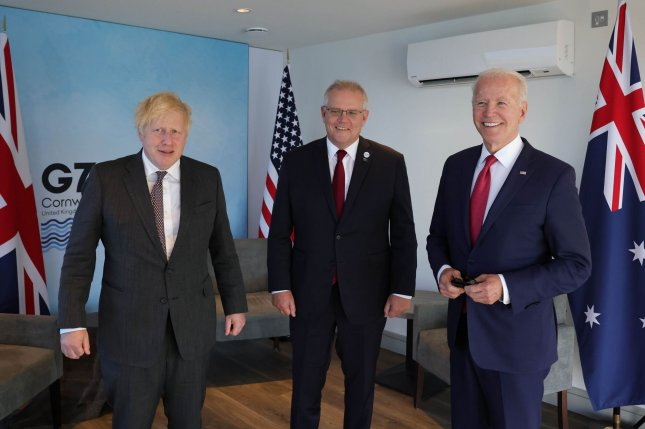 British Prime Minister Boris Johnson (L) stands with Australian Prime Minister Scott Morrison (C) on Saturday during a meeting with U.S. President Joe Biden at the Carbis Bay Hotel in Cornwall, Britain. Photo by Andrew Parsons/No. 10 Downing Street/UPI