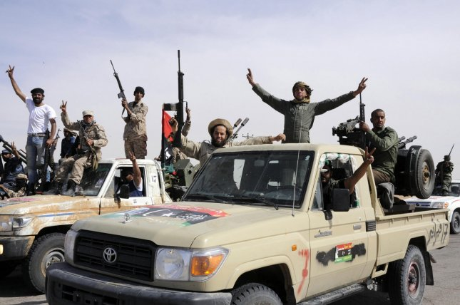 Rebel fighters celebrate after coming back from the front line against Moammar Gadhafi's forces, in Ajdabiya, Libya, Monday, May 9, 2011, where fighting between rebels and forces loyal to leader Moamer Kadhafi is ongoing. UPI\Tarek Alhuony.